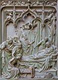 Милан - деталь от главным образом бронзового строба собора - рождение девой марии Ludovico Pogliaghi, 1906 Стоковые Фотографии RF