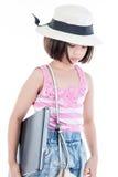 Милая азиатская девушка держа компьтер-книжку стоковые изображения