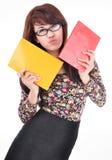 Милая азиатская девушка держа 2 цвета книг, красных и желтых Стоковое фото RF