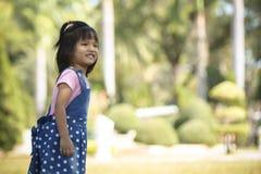 Милая азиатская девушка усмехается Стоковое Изображение