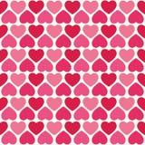 Милая безшовная картина сердец в пинке и красном цвете Стоковые Фото