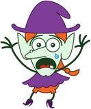 Милая ведьма хеллоуина плача и чувствуя вспугнутый Стоковая Фотография
