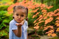 Милая девушка в саде стоковые фото