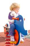 Милая девушка и кролик на спортивной площадке Стоковое Фото
