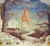 Милая девушка на качании в фантастическом небе Стоковые Изображения