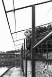Милая девушка на пристани на реке Стоковое фото RF