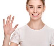 Милая девушка показывая ладонь стоковое фото rf