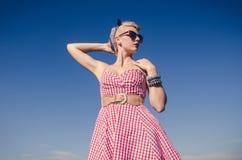 Милая девушка представляя в платье стоковые фотографии rf