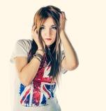 Милая девушка представляя в стиле моды Стоковое фото RF