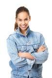 Милая девушка усмехаясь в голубой куртке джинсов джинсовой ткани Стоковое Фото