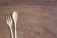 Милая деревянная ложка и вилка Стоковое Изображение RF