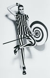 Милая женщина в striped верхней части и гетры с зонтиком Стоковые Изображения RF