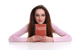Милая женщина держа английский словарь Стоковые Изображения RF