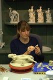 Милая женщина делая figurines Стоковое фото RF