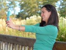Милая женщина и Techonology Стоковое фото RF