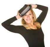 Милая женщина представляя с шляпой стоковые фото