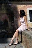 Милая женщина смотря стену Стоковое Изображение