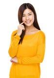 Милая китайская модель представляя с уверенностью Стоковое Фото