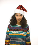 Милая маленькая девочка в изолированной шляпе santas красной Стоковое фото RF