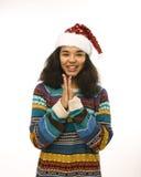 Милая маленькая девочка в изолированной шляпе santas красной Стоковые Фото