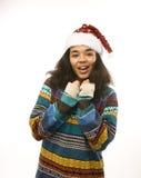 Милая маленькая девочка в изолированной шляпе santas красной Стоковые Фотографии RF