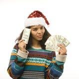 Милая маленькая девочка в шляпе santas красной при изолированные деньги Стоковые Изображения RF