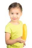 Маленькая девочка держа банан стоковые изображения