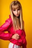 Милая маленькая девочка на желтой предпосылке Стоковое фото RF