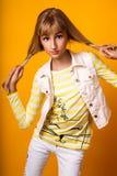 Милая маленькая девочка на желтой предпосылке Стоковые Изображения RF