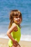 Милая маленькая девочка на пляже Стоковая Фотография