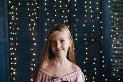 Милая маленькая девочка на темной предпосылке Стоковое Изображение