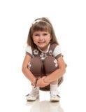 Милая маленькая девочка представляя в студии Стоковое Изображение