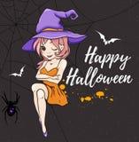 Милая молодая ведьма в фиолетовой шляпе Стоковые Фото
