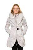 Милая молодая женщина в белом пальто стоковые изображения rf
