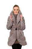 Милая молодая женщина в пальто стоковая фотография