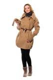 Милая молодая женщина в пальто стоковое изображение