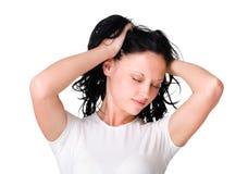 Милая молодая женщина ослабляя после трудного рабочего дня Стоковое Изображение