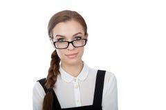 Милая молодая женщина при стекла смотря камеру Стоковое фото RF