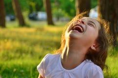 Милая смеясь над маленькая девочка Стоковые Фото
