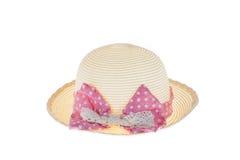Милая соломенная шляпа с розовой лентой на белой предпосылке Стоковая Фотография