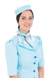 Милая стюардесса усмехаясь на камере Стоковые Изображения