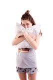 Милое объятие девушки изолированная подушка Стоковые Изображения RF