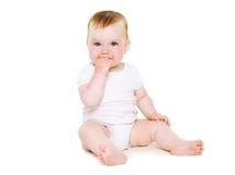 Милое усаживание младенца стоковые фото