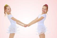Милые девушки держа руки Стоковая Фотография RF