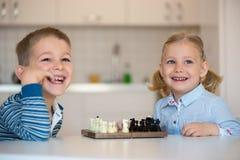 Милые дети играя дома Стоковая Фотография