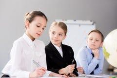 Милые дети работая в офисе Стоковое Изображение RF