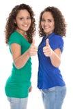 Милые изолированные маленькие девочки в голубом и зеленой с большими пальцами руки вверх: re стоковое фото rf