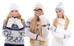 Милые красивые девушки в одеждах зимы изолированных на белизне Стоковое Изображение RF
