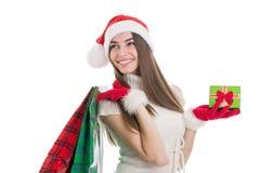 Милые покупки девочка-подростка для рождества Стоковые Изображения