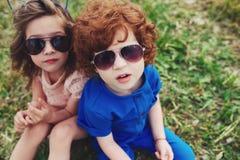 Милые стильные дети в парке лета Стоковые Фото